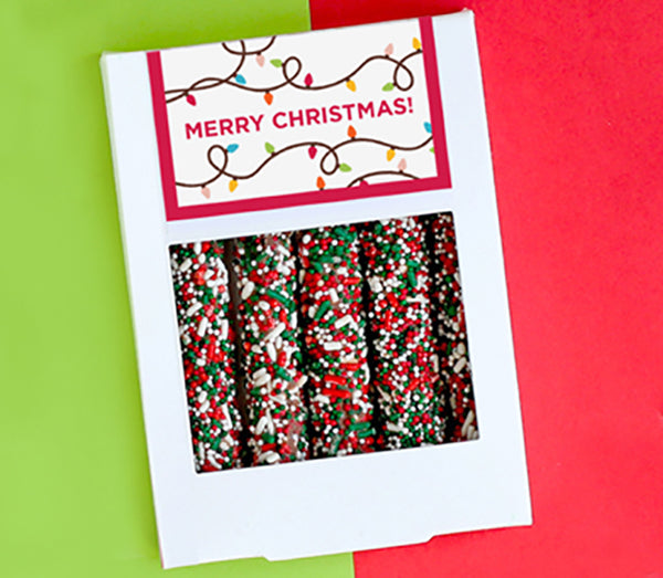 White box of five pretzels with red, green and white sprinkles and customized Christmas design