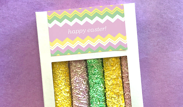 White box of five pretzels with pastel colored sprinkles and customized Easter design