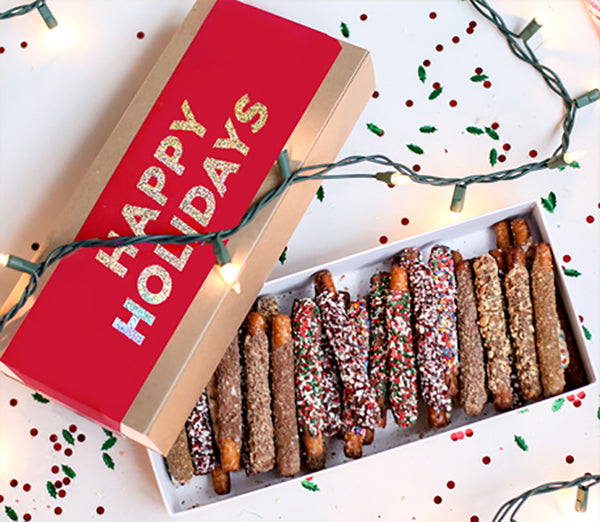 Chocolate covered pretzel holiday gift box with thirty pretzels in assorted flavors