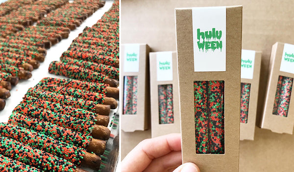 Kraft boxes of two pretzels with orange, green and black sprinkles pretzels and Hulu Halloween logo design