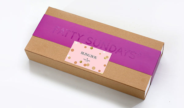 Gift box of chocolate covered pretzels with custom Kate Spade label