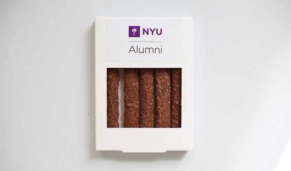 White box of five chocolate pretzels with crumbled cookie topping and NYU logo design