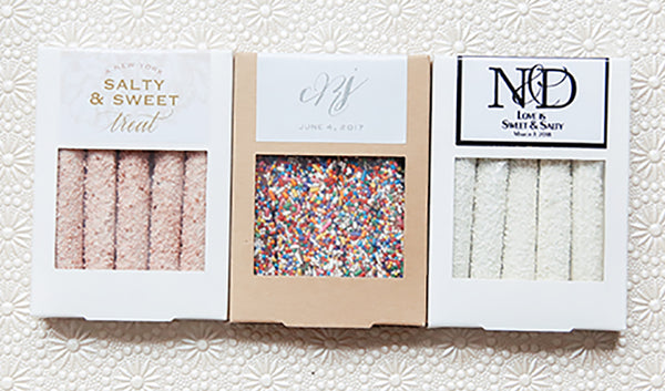Boxes of five chocolate covered pretzels each with customized wedding design