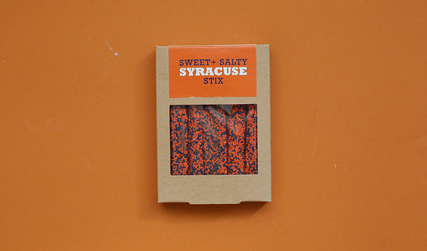 Kraft box of five chocolate pretzels with navy and orange sprinkles and Syracuse logo design