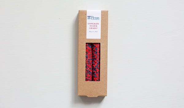 Kraft box of two pretzels with red and blue sprinkles and UPenn logo design