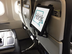 Use TabletHookz to provide hands-free entertainment on your flight