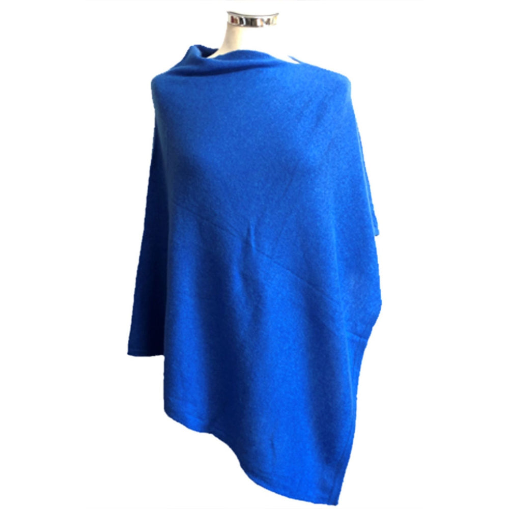 Cobalt colored poncho on dress form