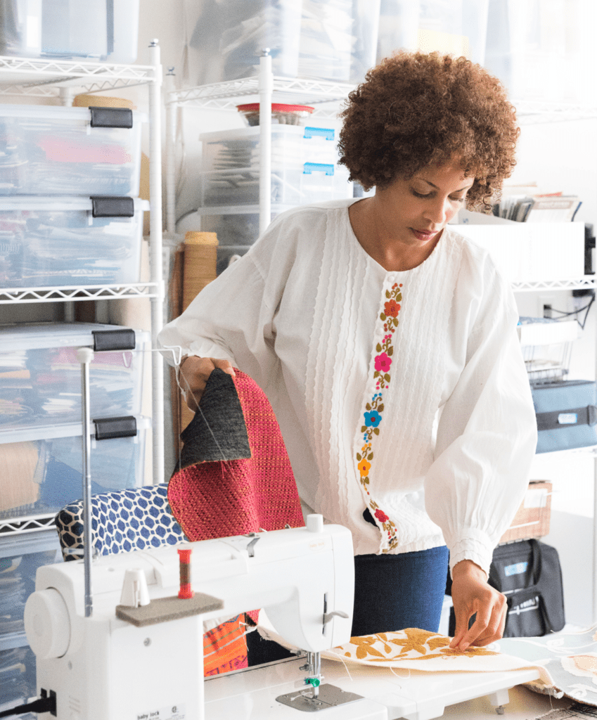 Cherise Rollins working in sewing studio how we live home tour blog