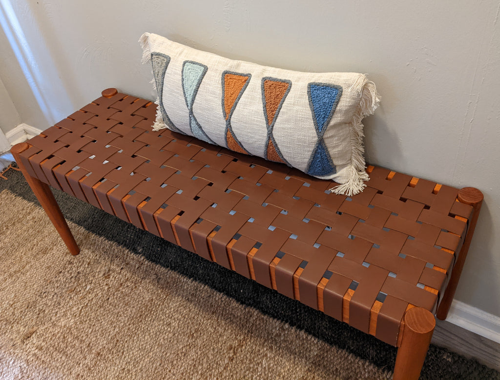 leather strap bench with cream and blue modern lumbar pillow