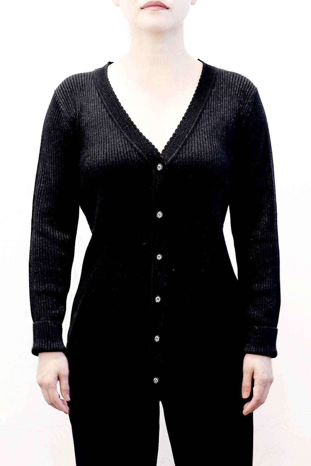 emma chai Light knit. Shimmering soft-to-the-touch black metallic cardigan. Button closures at center front. Neckline [ ] . 30% wool, 30% silk. Dry clean. May hand wash cold, using baby shampoo or mild detergent. Style #180116. Imported @emmachaioficial emma chai