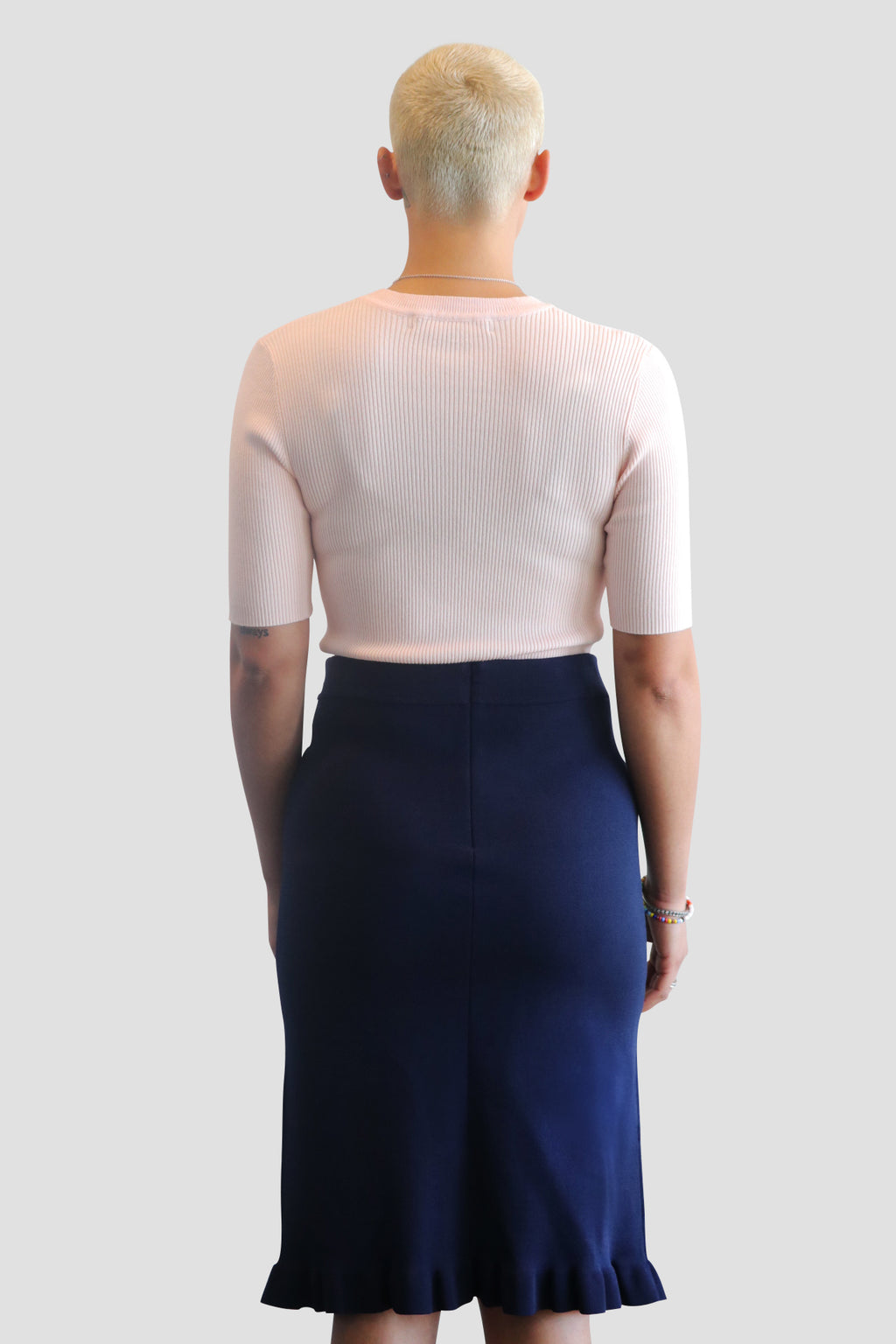 emma chai stretch knit skirt. stretch knit skirt. pencil skirt. ruffle skirt.