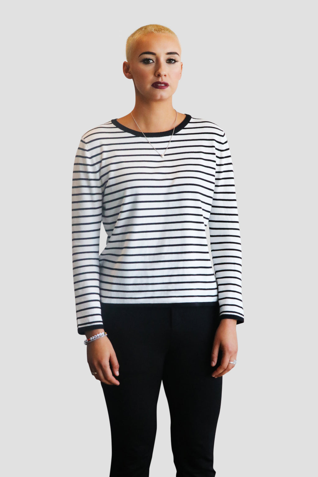 "The Gaia pullover is designed with black and white stripes—the contrasting colors are inspired by the 1970s ""Women United"" black and white photo in Time magazine. This causal luxury piece is made with silky-soft stretch-knit, making it comfortable to wear for any occasions and throughout the seasons.  Finished with black trim along the neck, cuffs, and hem Slightly loose fit to offer a feminine, flowy, yet figure flattering fit Take your normal size  Light knit @emmachaiofficial"