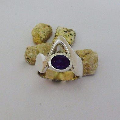 "We designed this ring set with an amethyst to represent the ""moody skies and changing weather"" that can often be seen surrounding the mountain ranges."