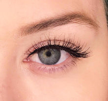 A soft wispy natural false synthetic eyelash from Dollhouse Lashes in style Boss Lady