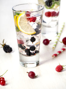 Fresh berry lemonade with red currant, gooseberry and blackberry