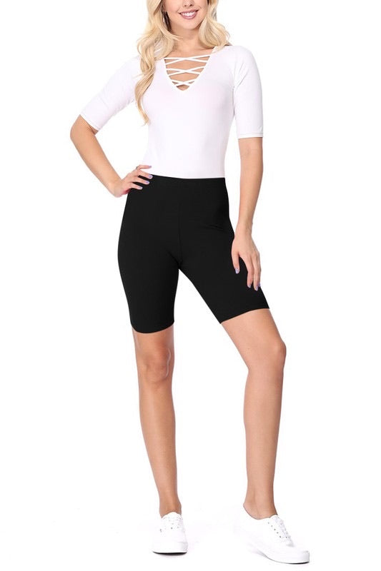 Cotton solid high waist biker shorts in color black with elastic waist. Approximate length is 16 inches from waist to hem. Waist 26 inches in size small.
