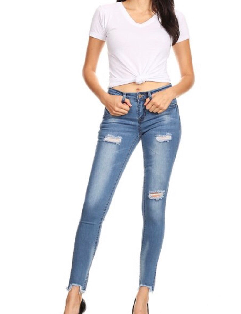Mid-rise distressed jean
