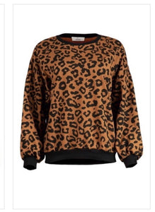 Long sleeve puff sleeve style leopard print sweater. 95% Polyester and 5% spandex material so it isn't very heavy. It has a black elastic waistband as well as black elastic on the sleeve ends. Sweater has high scoop neck. .