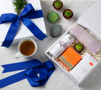 Comfort Gift Box laid out with cup of tea