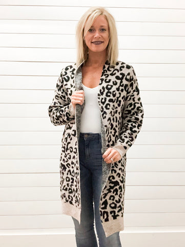Animal Print Knit Cardigan on Blush Background