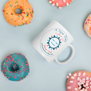 A New Day Coffee Company mug with logo and donuts