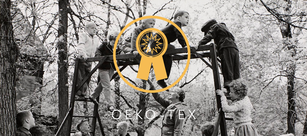 Children playing outside on monkey bars, and oeko tex certification symbol.