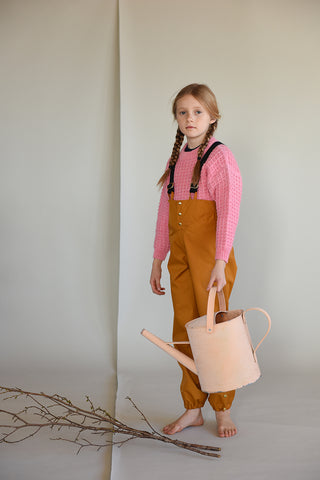 Faire Child kids waterproof trousers made from recycled polyester in Acorn