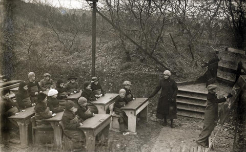 Image of the McMillian sisters teaching class outdoors.
