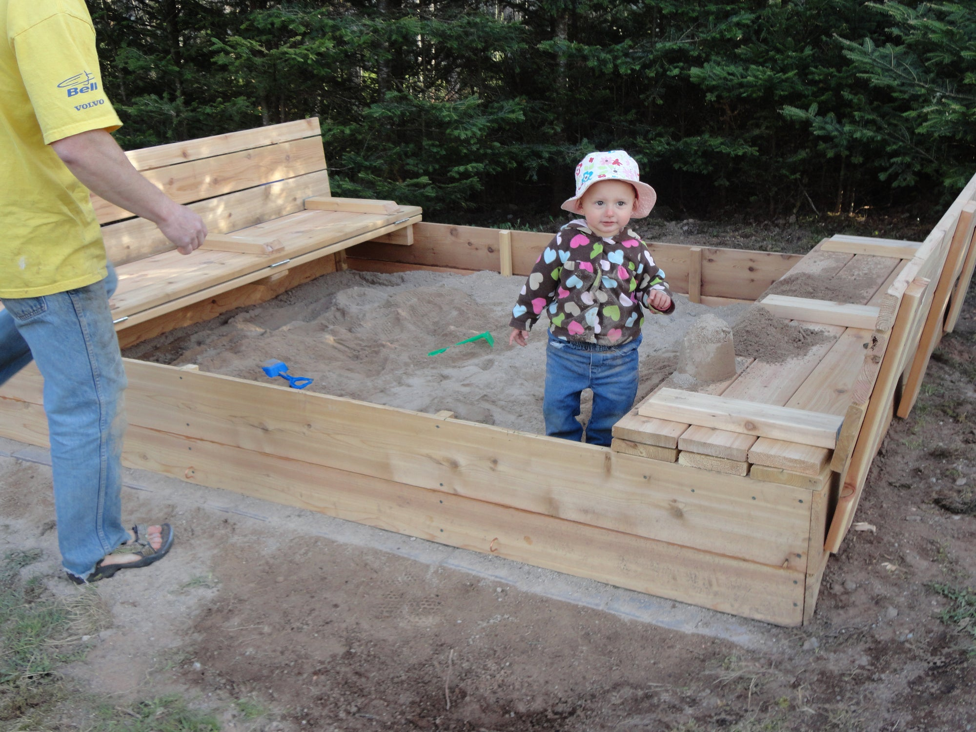 Wooden sandbox with foldable seats