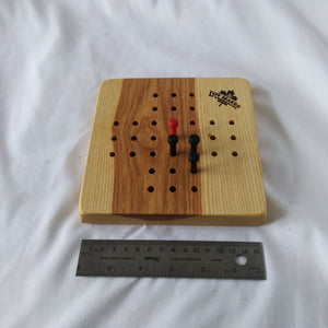 Wooden peg jumping game