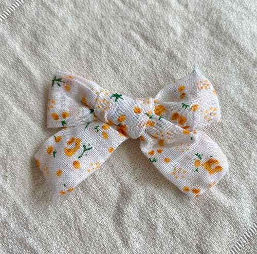 bebe bow clip (orange blossom)