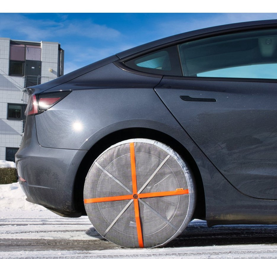 Side view of AutoSock assembled on a rear wheel of a Tesla Model 3