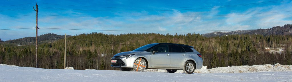 AutoSock works on snow for passenger car standing in nature