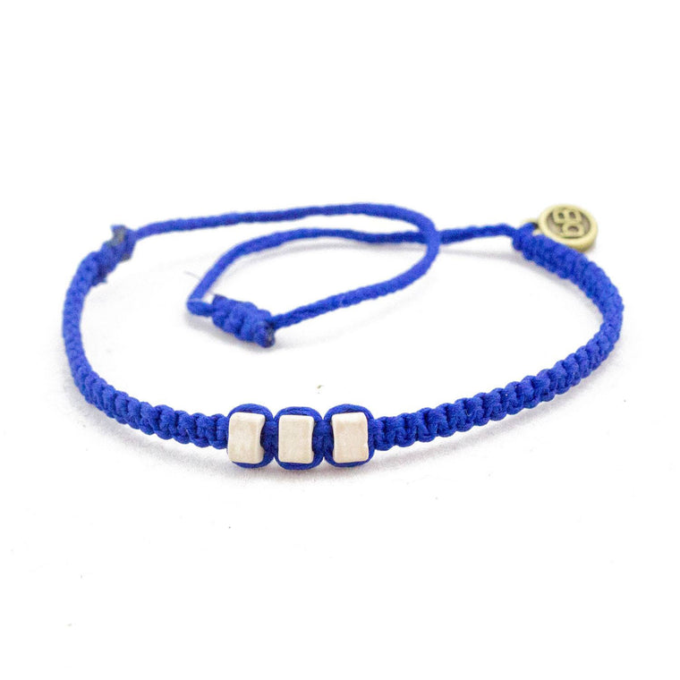 White Chasqui Electric Blue bracelets that help children cover