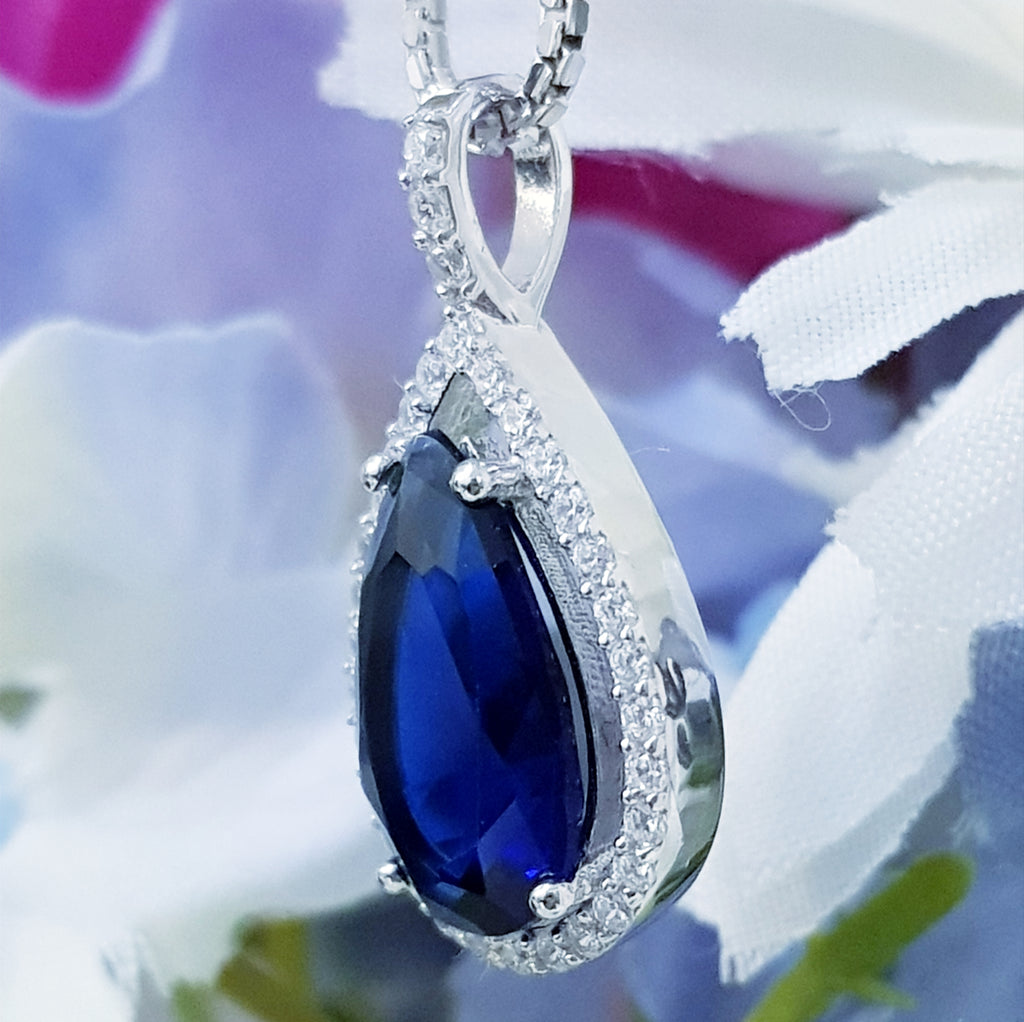 Large blue teardrop shaped necklace, sterling silver pendant