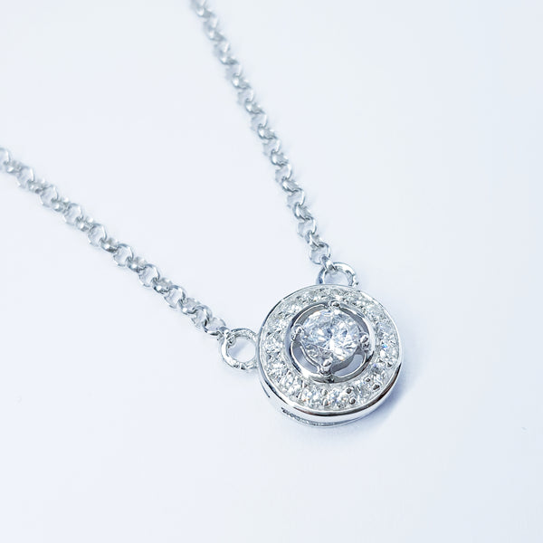 Small round sterling silver necklace with halo