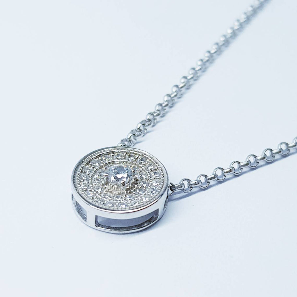 Dainty round necklace floating on sterling silver chain
