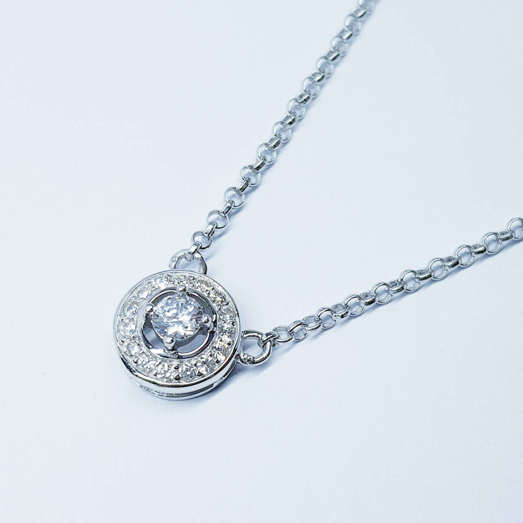 Small round pendant floating on sterling silver chain