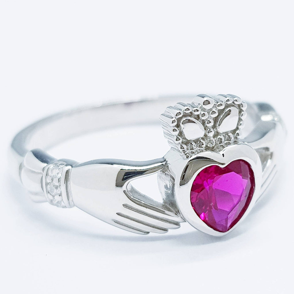 Sterling Silver Claddagh ring set with ruby red heart shaped stone, July birthstone claddagh ring