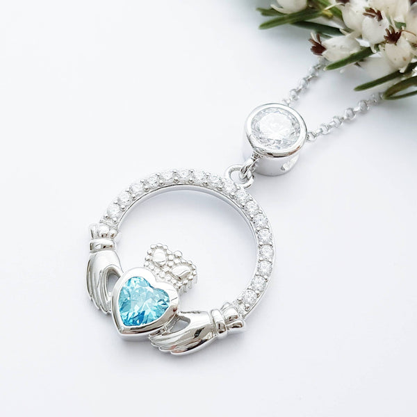 Sterling silver claddagh necklace set with light blue aquamarine  birthstone from Ireland