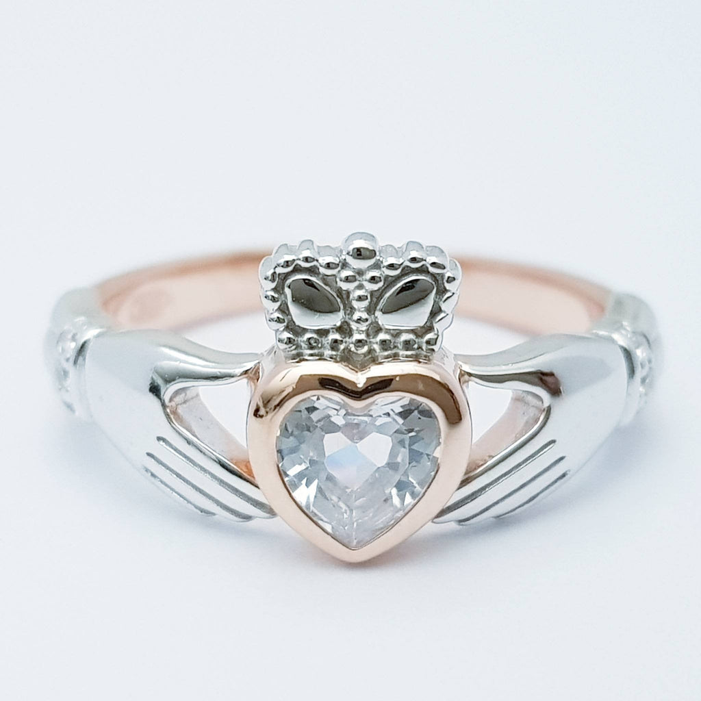 Sterling Silver Rose Gold plated Claddagh ring set with sparkling white cubic zirconia, heart and hands ring
