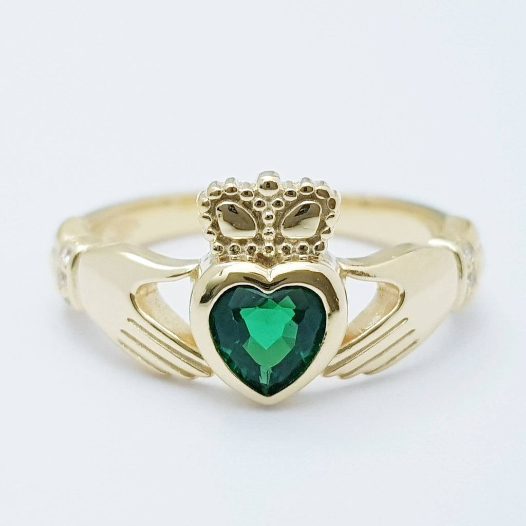 Sterling Silver Yellow Gold plated Claddagh ring set with emerald green heart shaped stone, may birthstone claddagh ring from Ireland