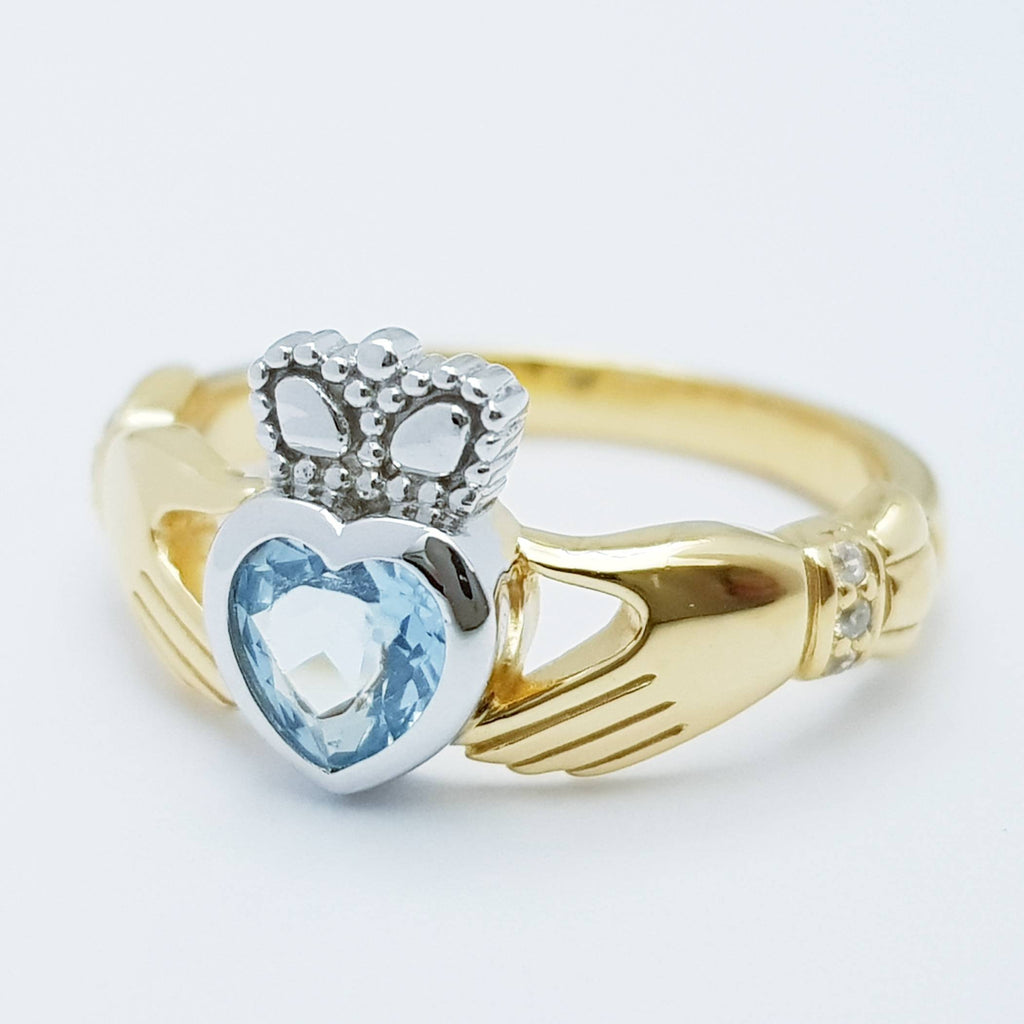 Sterling Silver Gold plated Claddagh ring set with light blue aquamarine stone, irish claddagh rings