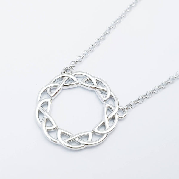 Double sided celtic knot pendant, silver round celtic necklace made in Ireland with angel wing chain