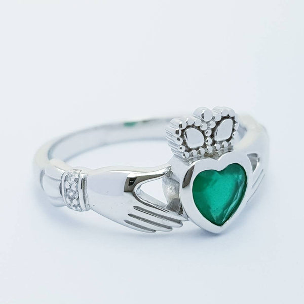 Sterling Silver Claddagh ring set with emerald green heart shaped stone, may birthstone claddagh ring from Ireland