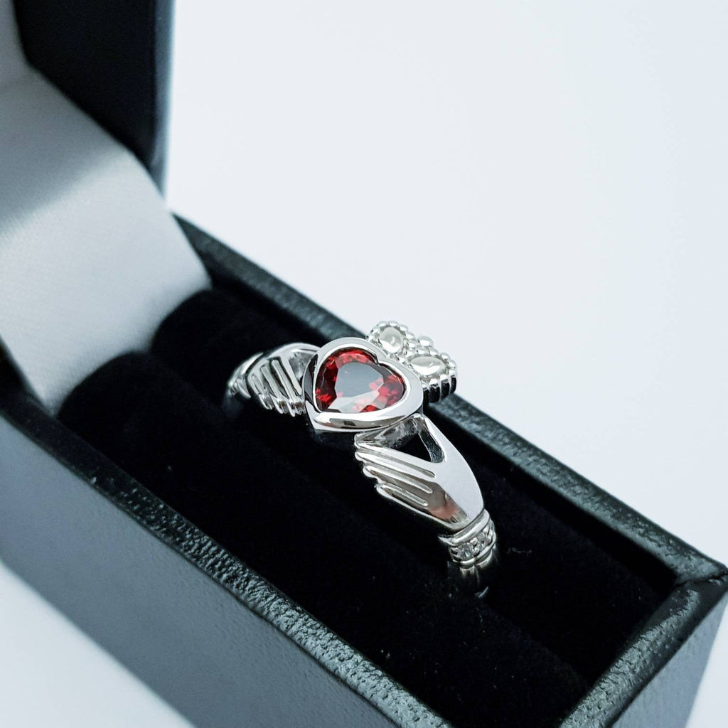 Sterling Silver Claddagh ring set with red garnet heart shaped stone, Irish claddagh rings