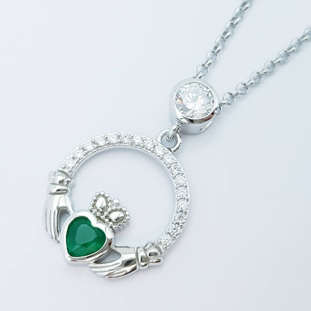 Sterling silver claddagh necklace with emerald green heart shaped stone