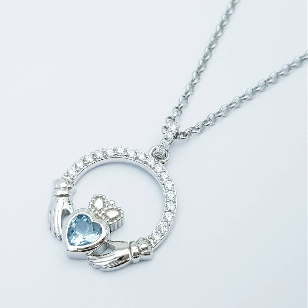 Sterling silver claddagh necklace  with light blue aquamarine heart shaped stone, march birthstone