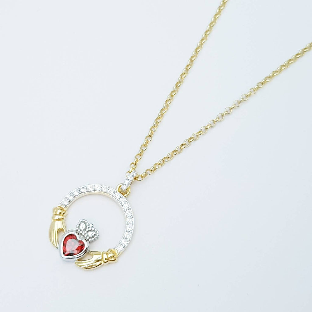 Gold plated claddagh necklace  with red garnet heart shaped stone, January birthstone