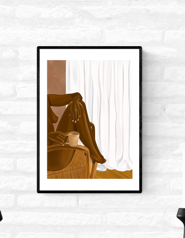 Framed wall art print of a nude black woman sitting in a chair with her feet up and a cup of tea